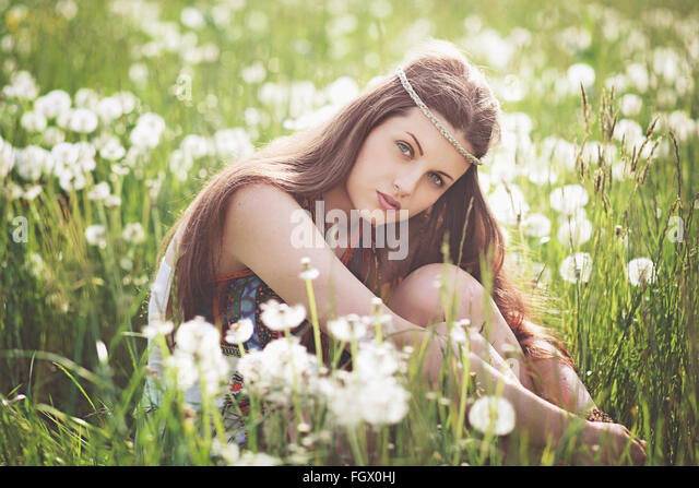 Beautiful free girl in a flowered meadow. Summer portrait - Stock Image