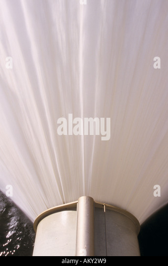 Plume from irrigation valve at base of dam spillway, Hume Dam, Albury, New South Wales, Australia - Stock Image