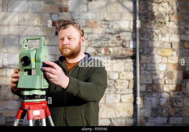 archaeology student with mapping device - Stock Image