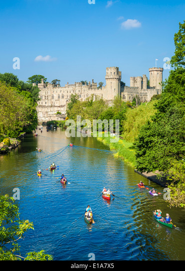 Tourist canoes, Warwick Castle and River Avon Warwick Warwickshire, England UK GB EU Europe - Stock Image
