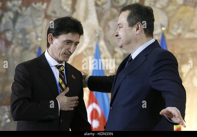 Belgrade, Serbia. 13th Dec, 2016. Ukrainian Ambassador to Serbia Oleksandr Aleksandrovych (L) and Serbia's Foreign - Stock Image