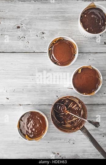 Chocolate dough for fondant in the ramekin vertical - Stock Image