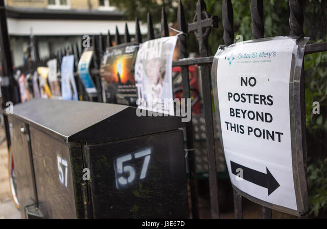 The University city of Cambridge in England with posters on railings - Stock-Bilder
