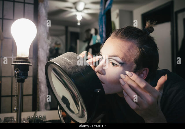 Male drag queen putting on make up and dressing up in prepration for a performance - Stock-Bilder