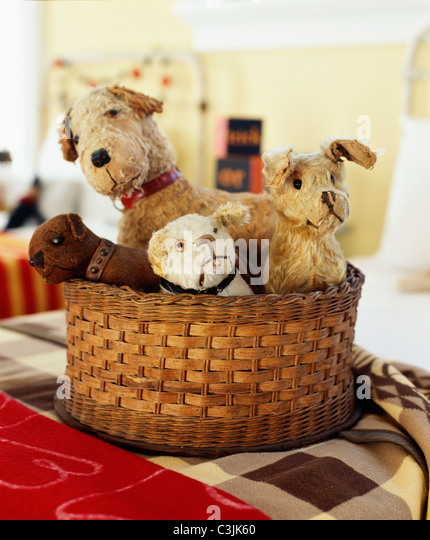 Basket of vintage stuffed animals. - Stock Image