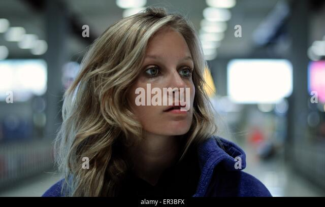 Portrait of a woman  at a station - Stock Image