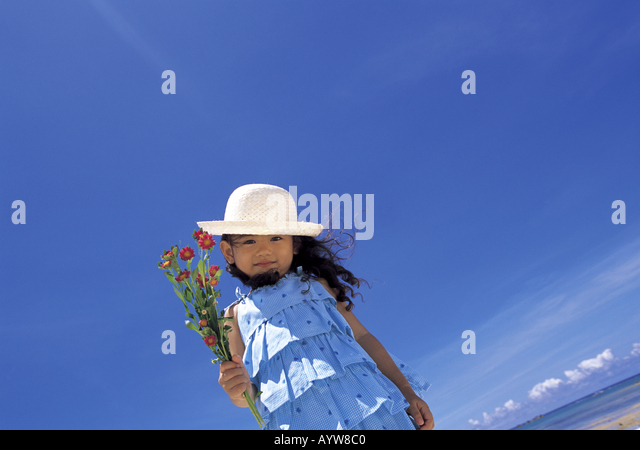 Girl in a straw hat with flowers - Stock-Bilder