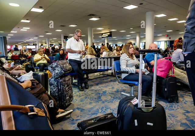 North Carolina Charlotte Charlotte Douglas International Airport inside terminal concourse gate area sitting seats - Stock Image