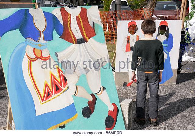 Miami Florida Kendall St. Andrew Greek Orthodox Church Greek Festival boy looking photo cutouts Greece national - Stock Image