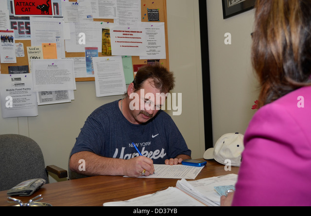 Male parolee meeting with female parole officer. Adult Parole in Omaha, Nebraska, USA. - Stock Image