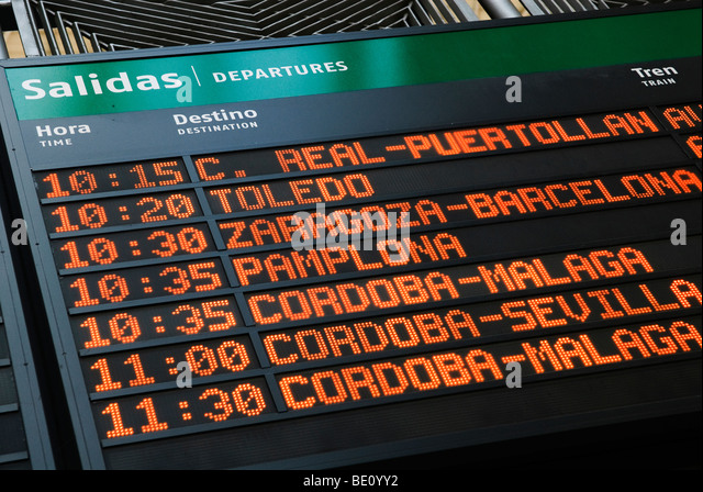 departure times of spanish trains on information board - Stock-Bilder