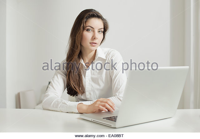 Young woman working on laptop - Stock-Bilder