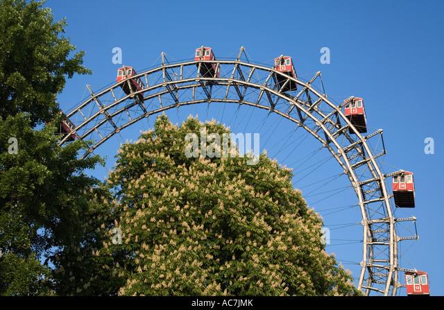 Vienna Austria Prater Big Wheel in spring blooming chestnut trees - Stock Image