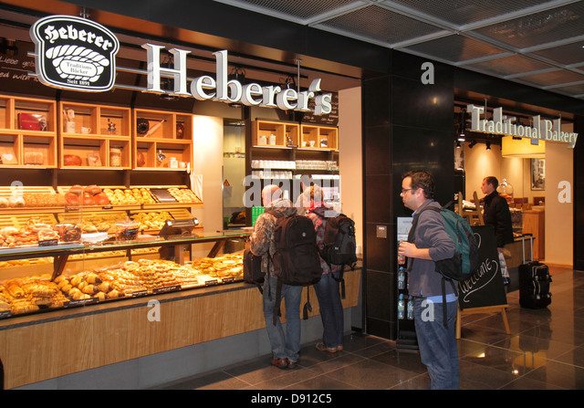 Germany Frankfurt am Main Airport FRA terminal gate area concourse shopping front entrance display for sale Heberer's - Stock Image