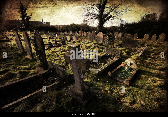 A church graveyard in the village of Castle Acre in Norfolk, England. Textures added in photoshop. - Stock Image