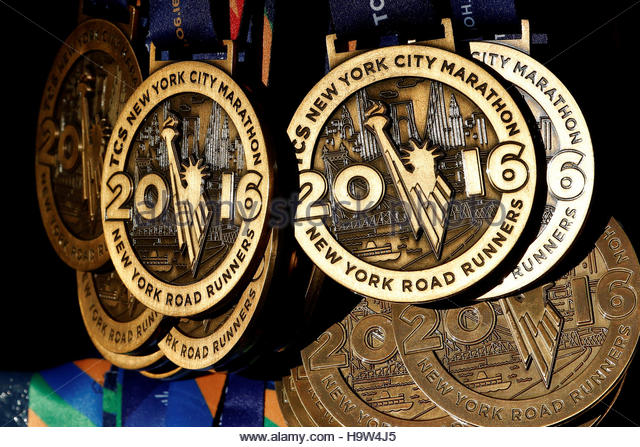 Medals are seen hanging ready for runners near the finish line ahead of the start of the 2016 New York City Marathon - Stock Image