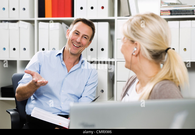 Two colleagues at work - Stock Image
