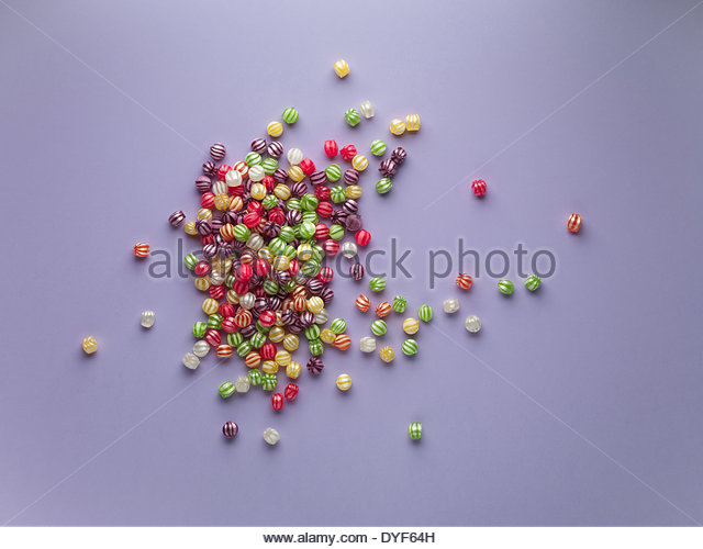 spread of vibrant hard candy - Stock Image