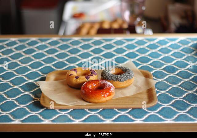 Three donuts on tray - Stock-Bilder