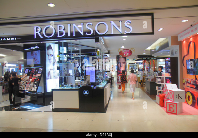 Singapore Raffles City Shopping Centre center shopping front entrance retail display for sale Robinsons fashion - Stock Image