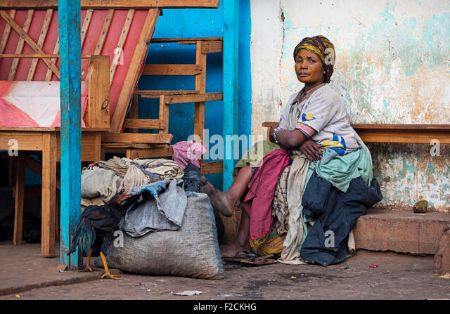 Poor Malagasy homeless woman in the city Ambalavao, Haute Matsiatra, Madagascar, Southeast Africa - Stock Image