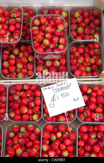 Small sweet strawberries on sale during the Ludlow 2012 Food Festival - Stock Image