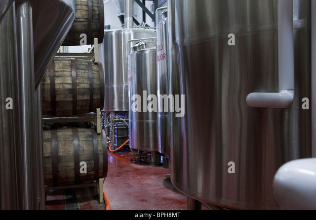 Fermentation tanks in a brewery - Stock Image