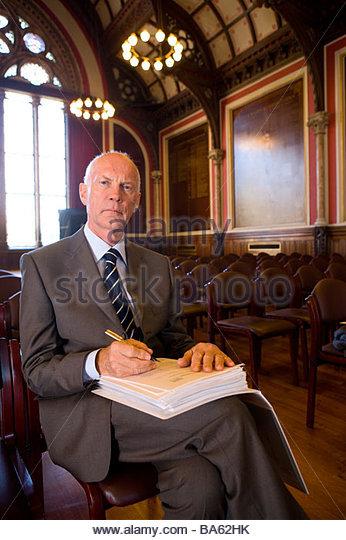 Senior male registrar preparing to sign document, portrait - Stock-Bilder