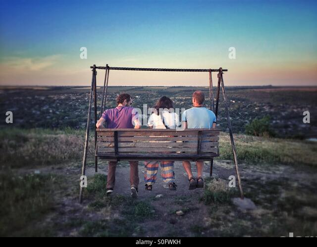 Friends on a swing - Stock-Bilder