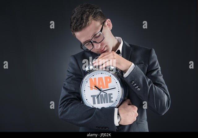 Businessman with clock sleeping in business concept - Stock Image