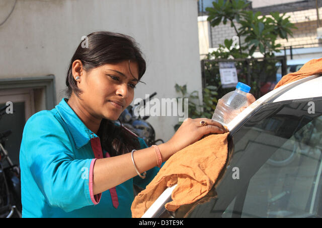 Gita cleans her cab in New Delhi, India, 22 February 2013. Most Indian women feel unsafe on the streets of New Delhi. - Stock Image