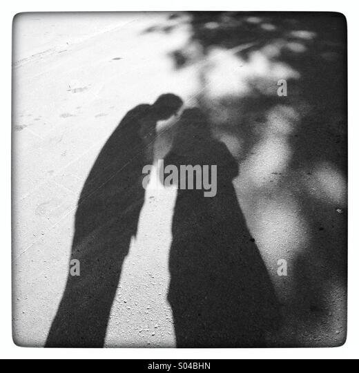 Shadows of a couple - Stock-Bilder