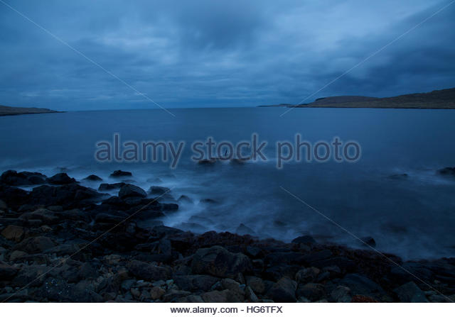 The tide in Twighlight Shetland - Stock Image