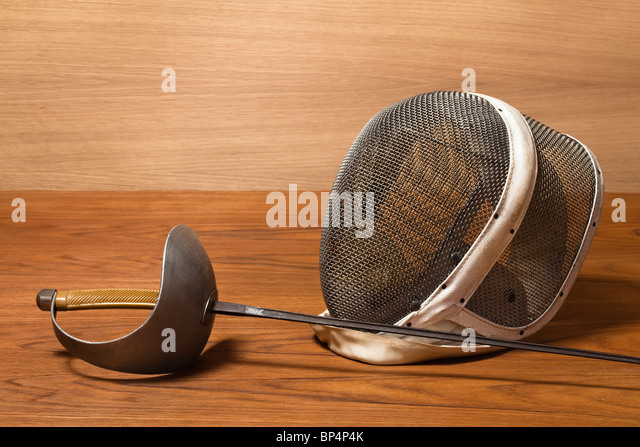fencing mask and sword - Stock Image