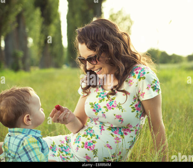 Mother with her lovely child in the park - Stock Image