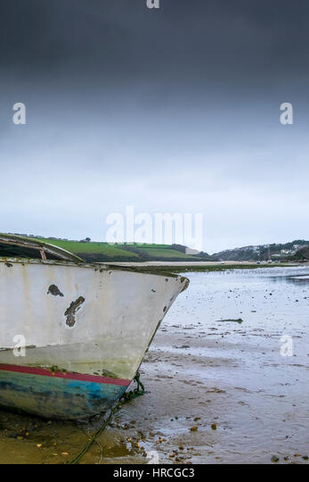 prow remains boat abandoned beached Gannel Estuary gloomy overcast day Newquay Cornwall UK weather - Stock Image