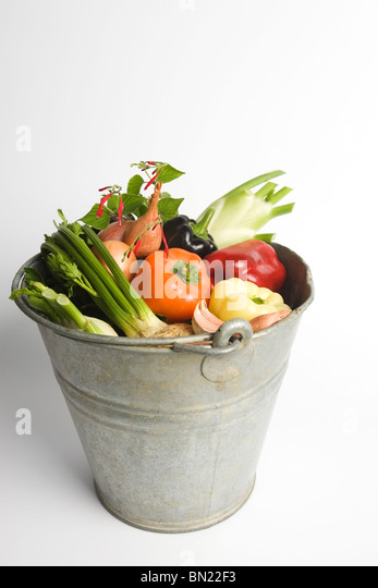 Bucket filled with assorted fresh vegetables - Stock Image