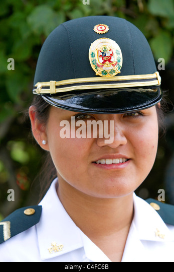 Female peruvian police officer in Lima, Peru. - Stock Image