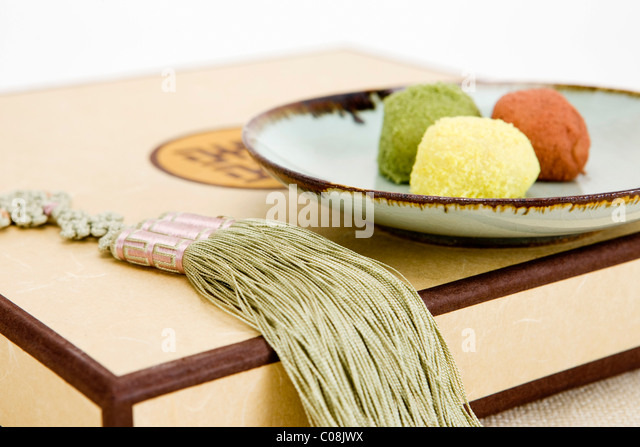 Korean traditional rice cake in a plate with adornment - Stock Image