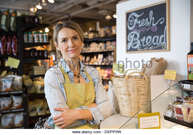 Portrait of worker in bakery at market - Stock Image