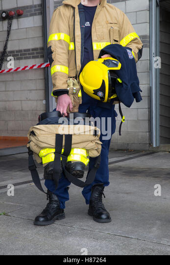 firefighter protection protective equipment suit - Stock Image