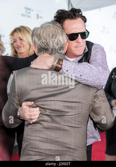 New York, USA. 28th Apr, 2017. New York, NY, USA - April 26, 2017: Michael Madsen hugs Harvey Keitel at 25th Anniversary - Stock Image