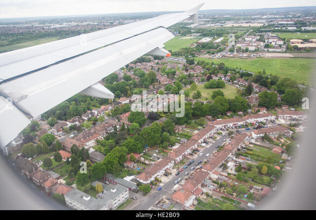 Plane about to land at Heathrow Airport. Flight from Paris to Heathrow,London.Flying over central London to Heathrow - Stock Image