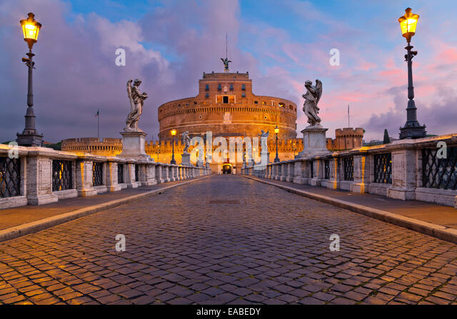 Image of the Castle of Holy Angel and Holy Angel Bridge over the Tiber River in Rome at sunrise. - Stock Image
