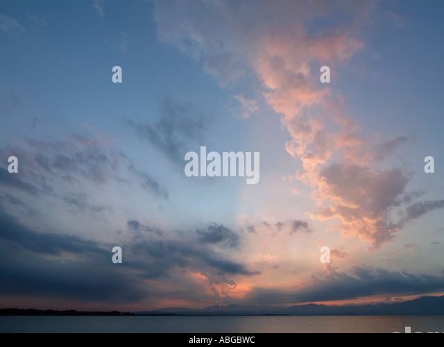 Beautiful cloud formation at sunset over Garda Lake Italy - Stock Image