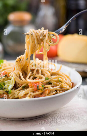 spaghetti with tomato sauce and herbs - Stock Image