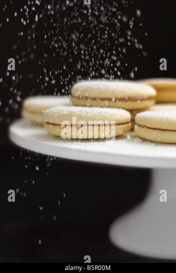 alfajores (latin american cookies stuffed with dulce de leche) - Stock Image