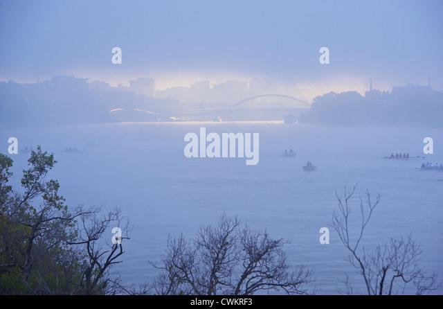 Brisbane city in morning fog, Queensland Australia - Stock Image
