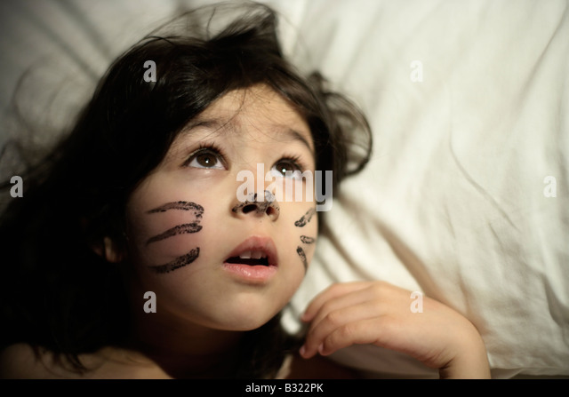 Five year old girl awakes with previous day's face paint. She played a cat in a school production and didn't - Stock Image