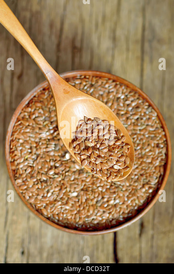 flax seeds shoot on wood in studio - Stock Image